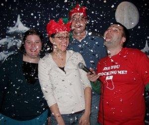 Karaoke + fake snow + elf hats = holiday awkwardness.