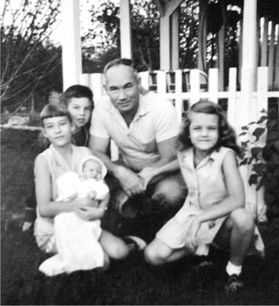 My grandfather with his first four children. That's my mom on his right.